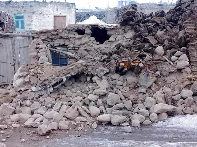 Houses are reduced to rubble after an earthquake hit villages in Baskale in Van province, Turkey, at the border with Iran, Sunday, Feb. 23, 2020. Turkish Interior Minister Suleyman Soylu said numerous people have been killed and several others wounded in Sunday's quake with more people trapped under debris. (IHA via AP)
