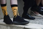 Scotland national Paul Mcque wears Hamilton socks in the entrance plaza of the Santurce Fine Arts Center moments before the premiere of the award-winning Broadway musical, Hamilton, starring its creator, New York native of Puerto Rican descent Lin-Manuel Miranda, in San Juan, Puerto Rico, Friday Jan. 11, 2019. The musical is set to run for two weeks and will raise money for local arts programs. (AP Photo/Carlos Giusti)