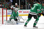 Dallas Stars goaltender Anton Khudobin (35) blocks a shot from the Minnesota Wild as defenseman John Klingberg (3), left wing Jamie Benn (14) and Wild center Eric Staal (12) look on in the second period of an NHL hockey game in Dallas, Tuesday, Oct. 29, 2019. (AP Photo/Tony Gutierrez)