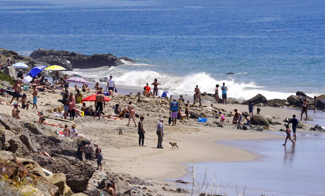 Several people utilize a beach, Friday, April 24, 2020, in Malibu, Calif. (AP Photo/Mark J. Terrill)