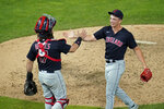 Cleveland Indians relief pitcher James Karinchak, right, and catcher Austin Hedges celebrate the team's 4-1 win over the Minnesota Twins in a baseball game, Thursday, June 24, 2021, in Minneapolis. Karinchak picked up the save. (AP Photo/Jim Mone)