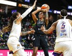 Seattle Storm's Mercedes Russell looks for a shot as Phoenix Mercury's Brittney Griner defends during the first half of a WNBA basketball game Friday, Sept. 17, 2021, in Everett, Wash. (Dean Rutz/The Seattle Times via AP)