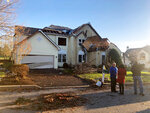 People stand in front of house damaged by Thursday nights severe weather in Thornbury Township, Pa., on Friday, Nov. 1, 2019. Homes have been destroyed in Pennsylvania and hundreds of thousands of utility customers were left without power after severe thunderstorms struck the Eastern Seaboard. At least 420,000 customers from South Carolina up to Maine and in Ohio were without power just before midnight Thursday.  (Anna Orso/The Philadelphia Inquirer via AP)