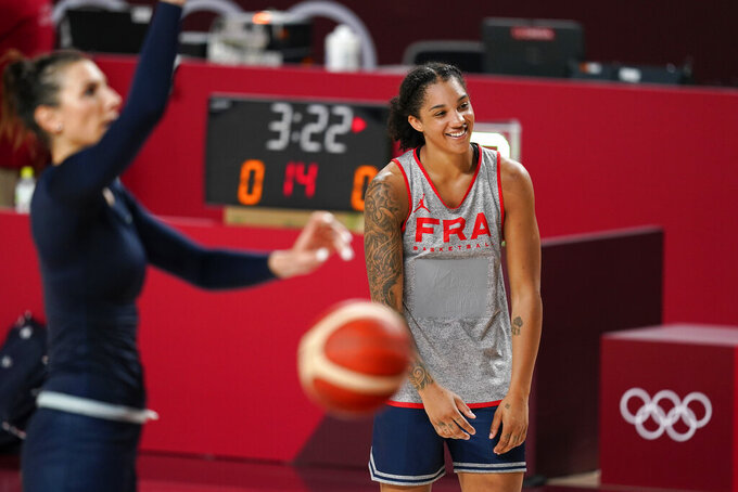 France's Gabby Williams laughs with teammates during a women's basketball practice at the 2020 Summer Olympics, Saturday, July 24, 2021, in Saitama, Japan. (AP Photo/Charlie Neibergall)