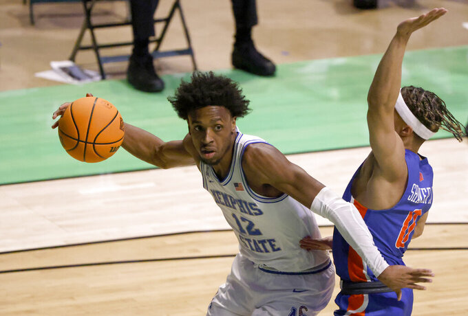 Memphis forward DeAndre Williams (12) is defended by Boise State guard Marcus Shaver Jr. (0) during the second half of an NCAA college basketball game in the semifinals of the NIT, Thursday, March 25, 2021, in Denton, Texas. (AP Photo/Ron Jenkins)