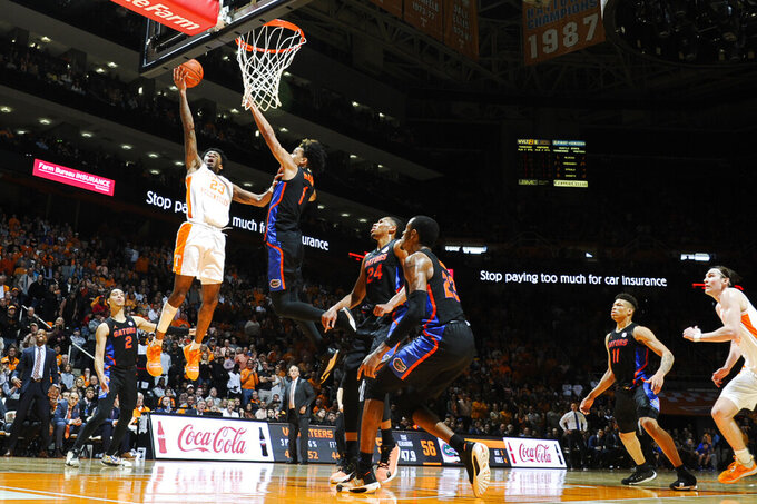 Tennessee guard Jordan Bowden (23) goes for a layup as Florida guard Tre Mann (1) defends during an NCAA college basketball game in Knoxville, Tenn., on Saturday, Feb. 29, 2020. (Calvin Mattheis/Knoxville News Sentinel via AP)