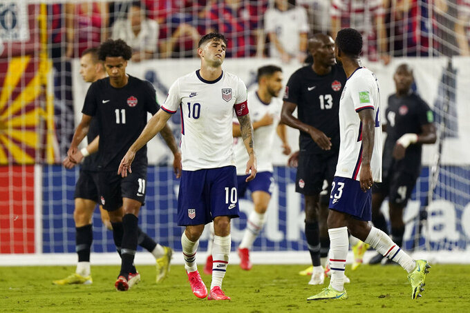 United States forward Christian Pulisic (10) reacts to missing a shot against Canada during the second half of a World Cup soccer qualifier Sunday, Sept. 5, 2021, in Nashville, Tenn. (AP Photo/Mark Humphrey)