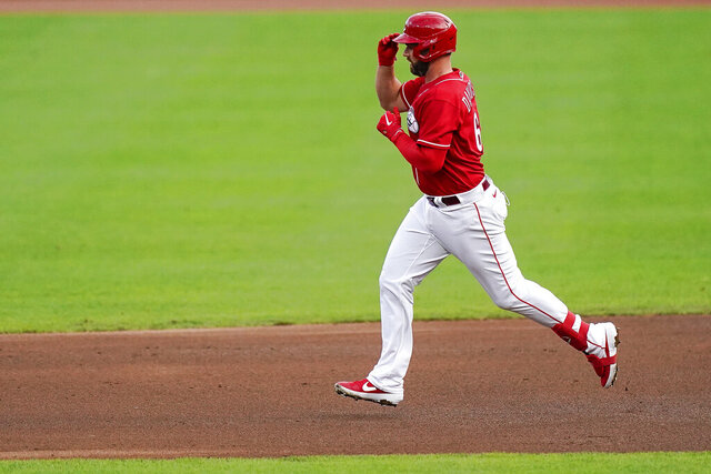 Cincinnati Reds infielder Matt Davidson touches his cap as he runs the bases after hitting a home run in the fourth inning of the exhibition baseball game against the Detroit Tigers at Great American Ballpark in Cincinnati, Wednesday, July 22, 2020. (AP Photo/Bryan Woolston)