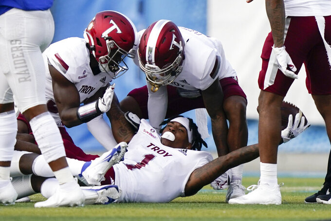 Troy cornerback Terence Dunlap (1) celebrates after intercepting a pass and losing his helmet against Middle Tennessee in the second half of an NCAA college football game Saturday, Sept. 19, 2020, in Murfreesboro, Tenn. Troy won 47-14. (AP Photo/Mark Humphrey)