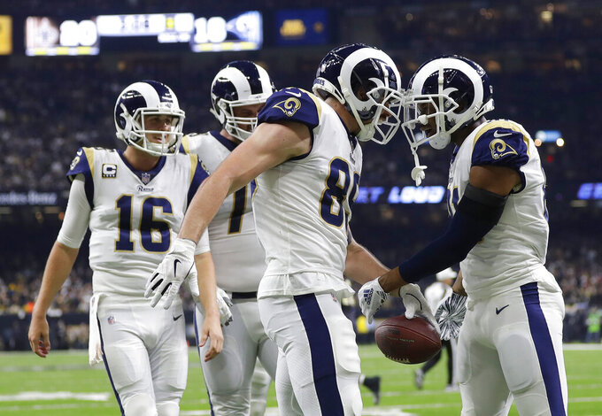 Los Angeles Rams' Tyler Higbee celebrates his touchdown catch during the second half of the NFL football NFC championship game against the New Orleans Saints, Sunday, Jan. 20, 2019, in New Orleans. (AP Photo/Gerald Herbert)