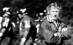 Minnesota Vikings coach Jerry Burns stands near players, date and location not known. Burns, the colorful character who took over as the Vikings' head coach in a time of turmoil and led the team to three playoff berths, has died. He was 94. The team announced Burns' death. Vikings spokesman Bob Hagan said Burns' son-in-law informed him of Burns' death Wednesday morning, May 12, 2021. (Bruce Bisping/Star Tribune via AP)