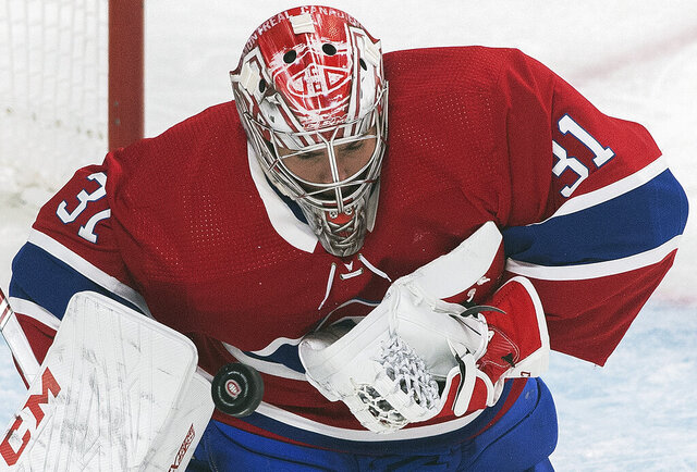Montreal Canadiens goaltender Carey Price makes a save during the second period of an NHL hockey game against the Detroit Red Wings, Saturday, Dec. 14, 2019, in Montreal. (Graham Hughes/The Canadian Press via AP)