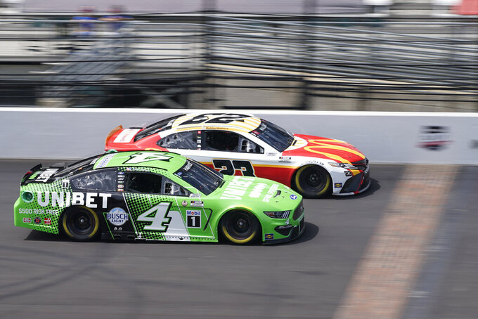Kevin Harvick (4) and Bubba Wallace (23) drive down the main straightaway during a NASCAR Series auto race at Indianapolis Motor Speedway, Sunday, Aug. 15, 2021, in Indianapolis. (AP Photo/Darron Cummings)