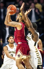 Boston College guard Ky Bowman (0) shoots a 3-point shot under as Wake Forest guard Chaundee Brown (23) defends during an NCAA college basketball game, Saturday, Jan. 26, 2019, in Winston-Salem, N.C. (Andrew Dye/The Winston-Salem Journal via AP)