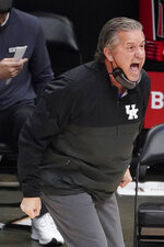 Kentucky head coach Jon Calipari yells to his team on the floor during the first half of an NCAA college basketball game against Georgia Tech, Sunday, Dec. 6, 2020, in Atlanta. (AP Photo/John Bazemore)