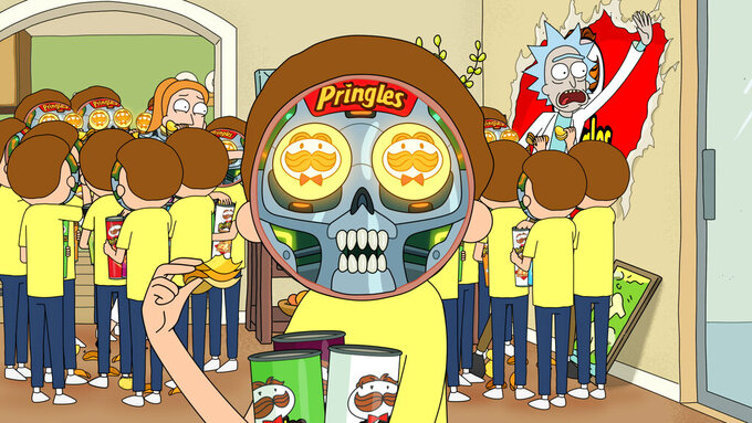"This undated file image provided by Pringles shows a scene from the company's 2020 Super Bowl NFL football spot which partners with the show ""Rick and Morty."" Pringle's enlisted Adult Swim's animated ""Rick and Morty"" duo with a meta ad in which the characters realize they're stuck inside a Pringles commercial. (Pringles via AP, File)"