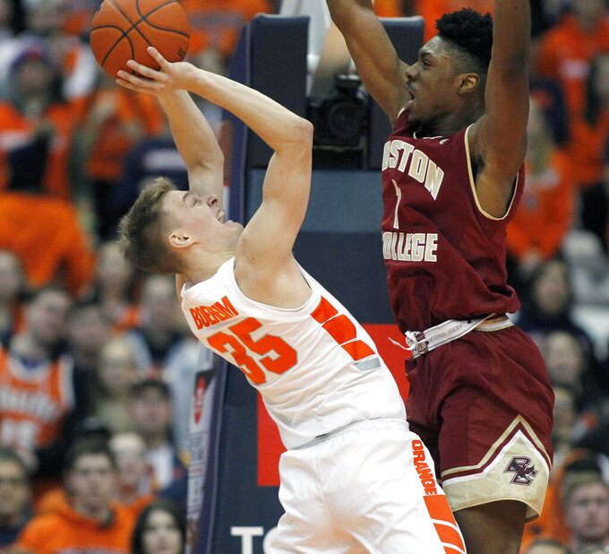 Syracuse's Buddy Boeheim, left, tries to shoot over Boston College's Jarius Hamilton, right, during the second half of an NCAA college basketball game in Syracuse, N.Y., Saturday, Feb. 9, 2019. Syracuse won 67-56. (AP Photo/Nick Lisi)