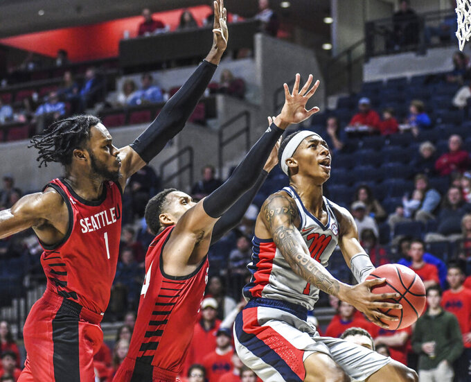 Mississippi guard Austin Crowley (1) drives past Seattle forward Myles Carter (1) and guard Delante Jones (24) to score during an NCAA college basketball game Tuesday, Nov. 19, 2019, in Oxford, Miss. (Bruce Newman/The Oxford Eagle via AP)