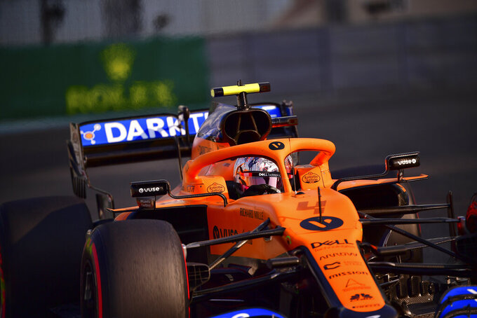 Mclaren driver Lando Norris of Britain in action during thrid practice at the Formula One Abu Dhabi Grand Prix in Abu Dhabi, United Arab Emirates, Saturday, Dec. 11, 2020 (Giuseppe Cacace, Pool via AP)