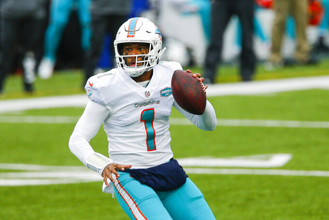 Miami Dolphins quarterback Tua Tagovailoa (1) looks to pass on the run in the first half of an NFL football game against the Buffalo Bills, Sunday, Jan. 3, 2021, in Orchard Park, N.Y. (AP Photo/John Munson)