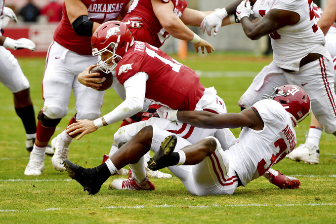 Arkansas quarterback Feleipe Franks (13) is tackled for a loss by Alabama defender Will Anderson Jr. (31) during an NCAA college football game Saturday, Dec. 12, 2020, in Fayetteville, Ark. (AP Photo/Michael Woods)