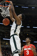 Michigan State's Xavier Tillman (23) dunks as Ohio State's C.J. Jackson (3) watches during the first half of an NCAA college basketball game in the quarterfinals of the Big Ten Conference tournament, Friday, March 15, 2019, in Chicago. (AP Photo/Kiichiro Sato)