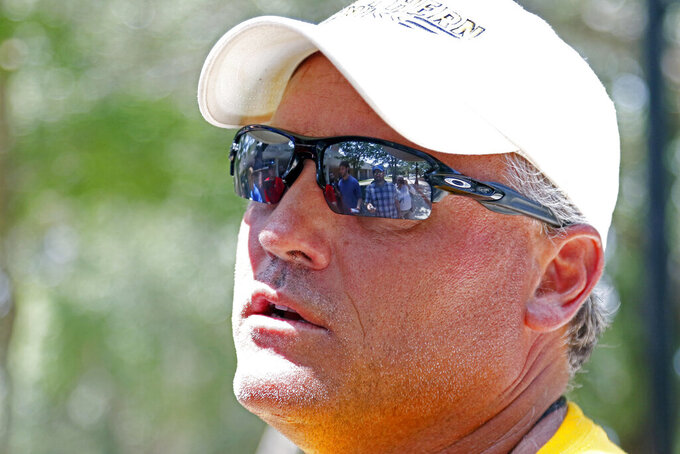 "FILE - In this Aug. 15, 2018, file photo, Southern Mississippi coach Jay Hopson speaks with reporters following NCAA college football practice in Hattiesburg, Miss. Southern Mississippi has decided not to hire Art Briles after interviewing the former Baylor football coach, a decision Golden Eagles coach Jay Hopson disagrees with. The school released a statement Wednesday, Feb. 6, 2019, from President Rodney D. Bennett and interim athletics director Jeff Mitchell saying ""following that meeting (with Briles), we informed him that he is not a candidate.""(AP Photo/Rogelio V. Solis, File)"