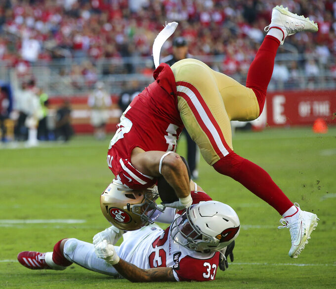 San Francisco 49ers fullback Kyle Juszczyk, top, is tackled by Arizona Cardinals cornerback Byron Murphy (33) during the second half of an NFL football game in Santa Clara, Calif., Sunday, Nov. 17, 2019. (AP Photo/John Hefti)