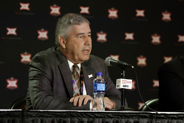 FILE - In this March 12, 2020, file photo, Big 12 commissioner Bob Bowlsby talks to the media after canceling the remaining NCAA college basketball games in the Big 12 Conference tournament due to concerns about the coronavirus in Kansas City, Mo. Big 12 schools still got a strong payout from the conference during the pandemic. The revenue distribution to the league's 10 schools for the 2019-20 school year averages $37.7 million each. That figure announced Friday, May 29, 2020, at the end of the league's virtual spring meetings was down only about $1.1 million a school from last year. (AP Photo/Charlie Riedel, File)
