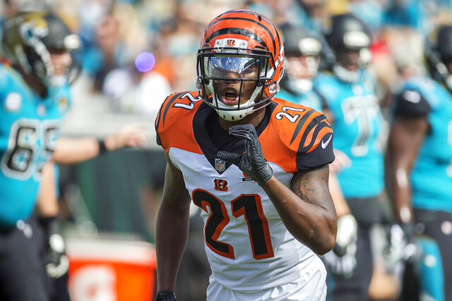 "FILE - In this Nov. 5, 2017, file photo, Cincinnati Bengals cornerback Darqueze Dennard (21) calls a formation to the defensive backs during the first half of an NFL football game against the Jacksonville Jaguars in Jacksonville, Fla. The Jacksonville Jaguars and Dennard have parted ways nine days after agreeing to a three-year, $13.5 million contract in free agency. The Jaguars said Thursday, March 26, 2020, ""the two sides could not come to an agreement on the final contract terms. (AP Photo/Stephen B. Morton, File)"