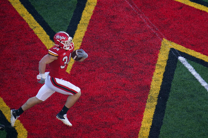 Maryland running back Jake Funk runs with the ball against Rutgers during the second half of an NCAA college football game, Saturday, Dec. 12, 2020, in College Park, Md. Rutgers won 27-24 in overtime. (AP Photo/Julio Cortez)