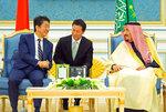 In this photo released by Saudi Press Agency, SPA, Saudi King Salman, right, receives Japan's Prime Minister Shinzo Abe, in Riyadh, Saudi Arabia, Sunday, Jan. 12, 2020. (Saudi Press Agency via AP)
