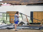 Business owners survey the damage of Hurricane Laura Friday, Aug. 28, 2020 in Lake Charles. Recovery efforts were underway after Hurricane Laura. (Chris Granger/The Times-Picayune/The New Orleans Advocate Via AP)