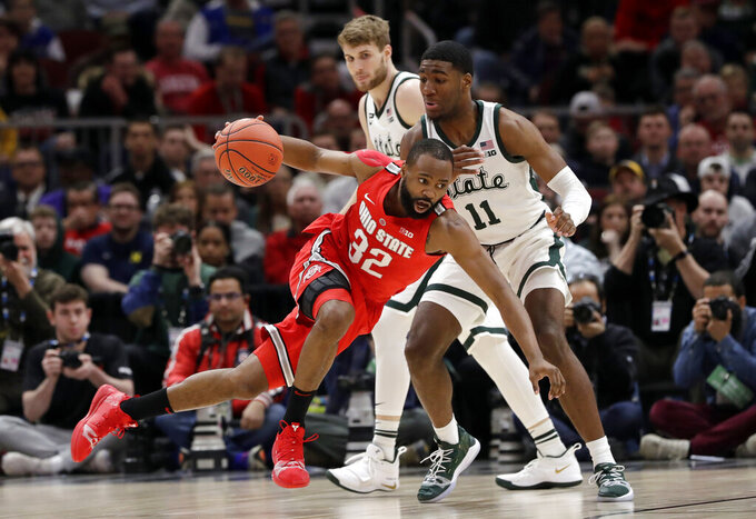 Ohio State's Keyshawn Woods (32) drives past Michigan State's Aaron Henry (11) during the second half of an NCAA college basketball game in the quarterfinals of the Big Ten Conference tournament, Friday, March 15, 2019, in Chicago. (AP Photo/Nam Y. Huh)