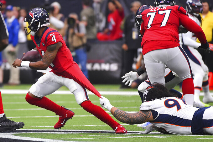 Houston Texans quarterback Deshaun Watson (4) is stopped by Denver Broncos nose tackle Mike Purcell (98) during the second half of an NFL football game Sunday, Dec. 8, 2019, in Houston. (AP Photo/Eric Christian Smith)