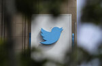FILE - This July 9, 2019, file photo shows a sign outside of the Twitter office building in San Francisco. Twitter is banning all political advertising from its service, saying social media companies give advertisers an unfair advantage in proliferating highly targeted, misleading messages. (AP Photo/Jeff Chiu, File)