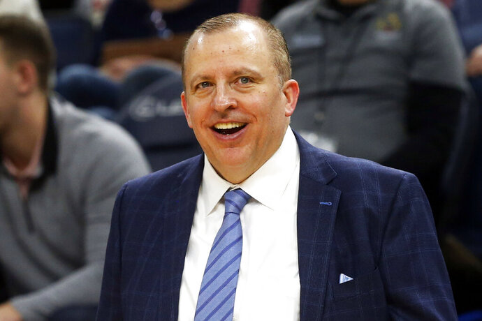 FILE - In this Jan. 4, 2019, file photo, Minnesota Timberwolves head coach Tom Thibodeau smiles in the waning moments as his team defeats the Orlando Magic in an NBA basketball game in Minneapolis. Thibodeau is back in New York as the Knicks' new coach. The former NBA Coach of the Year was hired Thursday, July 30,2020, returning to the team he helped lead to the NBA Finals as an assistant coach. (AP Photo/Jim Mone, File)