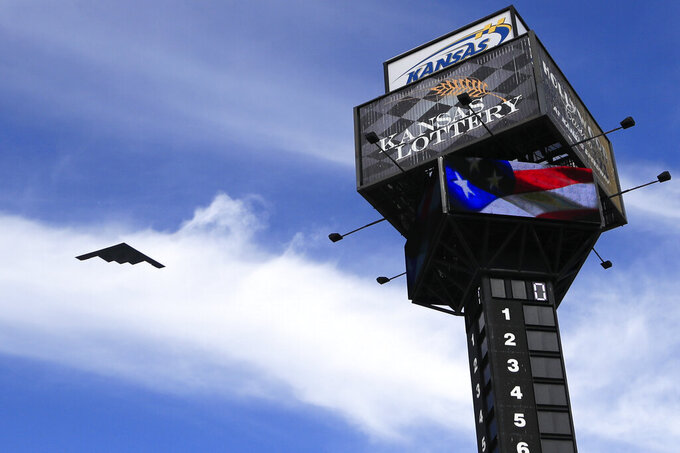 A B2 bomber flies over the leader pole before a NASCAR Cup Series auto race at Kansas Speedway in Kansas City, Kan., Sunday, Oct. 20, 2019. (AP Photo/Orlin Wagner)