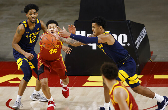 Iowa State guard Rasir Bolton (45) and West Virginia forward Jalen Bridges, right, chase down a loose ball during the first half of an NCAA college basketball game, Tuesday, Feb. 2, 2021, in Ames, Iowa. (AP Photo/Matthew Putney)