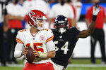 Kansas City Chiefs quarterback Patrick Mahomes (15) looks to pass under pressure from Baltimore Ravens linebacker Tyus Bowser (54) during the second half of an NFL football game, Monday, Sept. 28, 2020, in Baltimore. (AP Photo/Nick Wass)