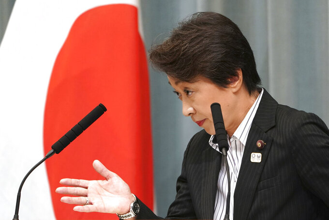 """FILE - In this Sept. 11, 2019, file photo, then newly appointed Minister in charge of the Tokyo Olympic and Paralympic Games Seiko Hashimoto speaks during a press conference at the prime minister's official residence in Tokyo. U.S. President Donald Trump's suggestion to postpone the Tokyo Olympics for a year because of the spreading coronavirus was immediately shot down by the Olympic minister. """"The IOC and the organizing committee are not considering cancellation or a postponement - absolutely not at all,"""" Hashimoto, an Olympic bronze medalist, told a news conference on Friday, March 13, 2020 in Tokyo. (AP Photo/Eugene Hoshiko, File)"""