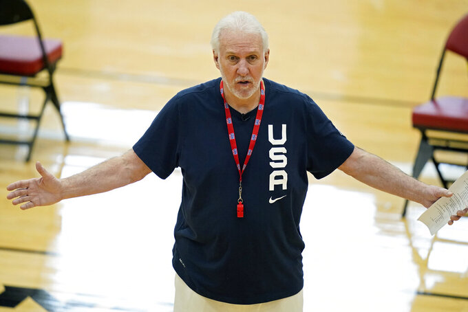 Head coach Gregg Popovich speaks with players during training for USA Basketball, Tuesday, July 6, 2021, in Las Vegas. (AP Photo/John Locher)