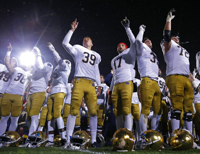 Notre Dame players celebrate their win over Northwestern after an NCAA college football game Saturday, Nov. 3, 2018, in Evanston, Ill. (AP Photo/Jim Young)