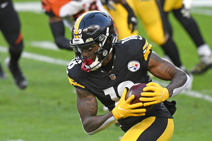 Pittsburgh Steelers wide receiver Diontae Johnson (18) runs after a catch during the first half of an NFL football game against the Cincinnati Bengals in Pittsburgh, Sunday, Nov. 15, 2020. (AP Photo/Don Wright)