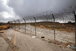 In this Friday, June 19, 2020 photo, a section of Israel's separation barrier blocks a road near the West Bank Jewish settlement of Beit Horon, Friday, June 19, 2020. (AP Photo/Oded Balilty)
