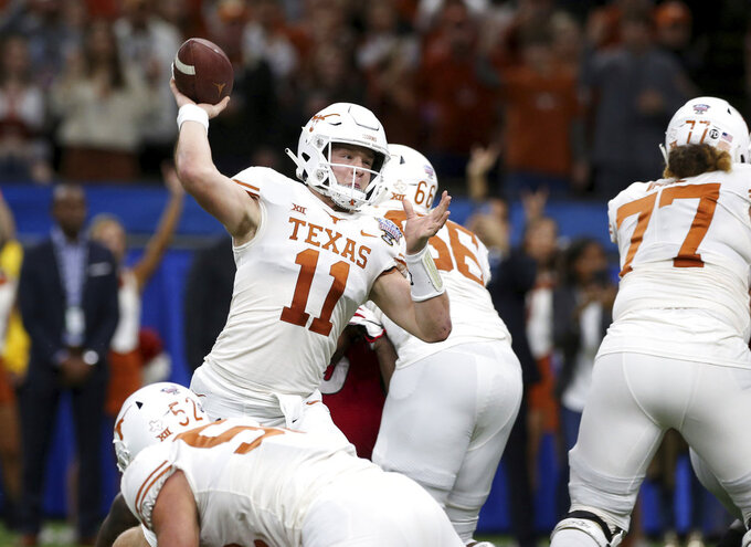 Texas quarterback Sam Ehlinger (11) throws a pass during the first half of the Sugar Bowl NCAA college football game against Georgia in New Orleans, Tuesday, Jan. 1, 2019. (AP Photo/Rusty Costanza)