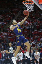 California guard Matt Bradley goes to the basket during the first half of the team's NCAA college basketball game against Utah on Saturday, Feb. 8, 2020, in Salt Lake City. (AP Photo/Rick Bowmer)