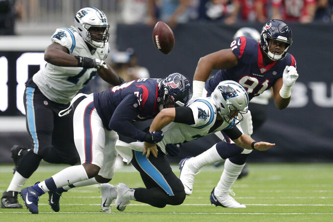 Carolina Panthers quarterback Kyle Allen (7) fumbles as he is hit by Houston Texans outside linebacker Whitney Mercilus (59) during the first half of an NFL football game Sunday, Sept. 29, 2019, in Houston. (AP Photo/Michael Wyke)