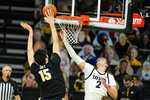 Iowa forward Jack Nunge (2) drives to the basket ahead of Purdue center Zach Edey (15) during the first half of an NCAA college basketball game, Tuesday, Dec. 22, 2020, in Iowa City, Iowa. (AP Photo/Charlie Neibergall)