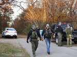 The manhunt for murder suspect Michael Brown continues on Friday as police are on scene at Palmer Avenue near train tracks in northeast Roanoke. (Heather Rousseau/The Roanoke Times via AP)